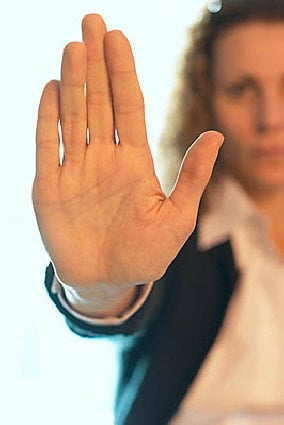 woman with stop sign hand signal