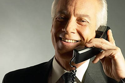 business man talking on telephone and smiling