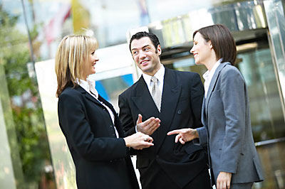 3 business people talking