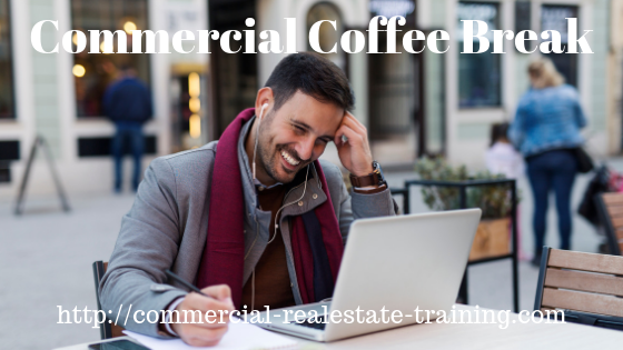 real estate person smiling at computer screen